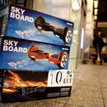 A view of a hoverboard for sale at a small store in New York, New York, USA, 15 December 2015. There have been recent reports of similar devices catching on fire and some cities, including New York, have made illegal to ride them on the street.  EPA/JUSTIN LANE