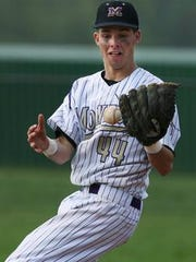 Marc Magliaro playing shortstop for Monroe High School