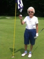 Jean Giuliano holds up the ball she sank on the par-3 eighth hole at Flanders Valley on July 5. (Photo courtesy of New Jersey State Golf Association)