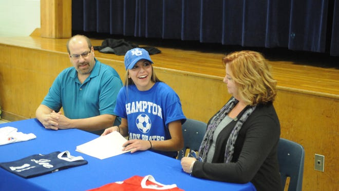 Sara Sabo, middle, signed her national letter of intent Monday afternoon to play soccer for Hampton University. Beside her are her parents, Bill and Tanya Sabo.