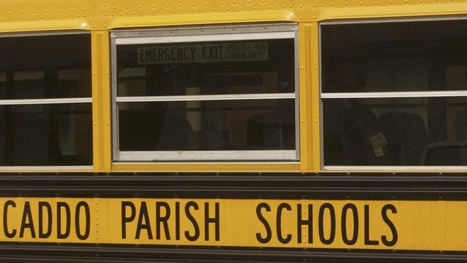 - -Photo by Mike Silva - scanned 030805 - New Caddo Parish Schools buses have tinted windows.