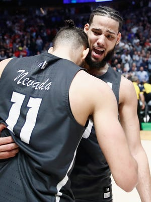 Caleb Martin celebrates with Cody Martin of the Nevada Wolf Pack after defeating the Cincinnati.