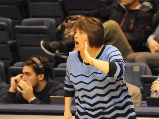 Monmouth women's basketball coach Jenny Palmateer shouts instructions to her players last season.