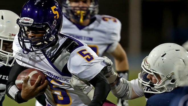 Johnston's #5 T-Boy White, left, was grabbed by the jersey by Roosevelt's #50 Jake Martin in football game at Drake Stadium on Friday night Oct. 3, 2014.