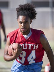 Xavier Palmer practices with the South Mountain High