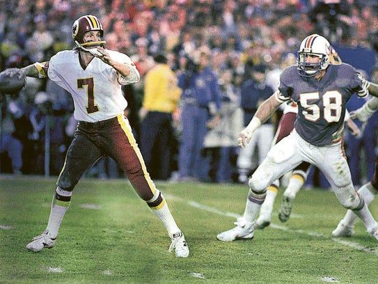Washington Redskins quarterback Joe Theismann (7) gets