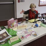 "Judy Braiman, founder of Rochester-based Empire State Consumer Project, displays ""toxic toys"" in 2009."