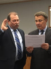 Joe Pagano (left) is sworn in as a new member of the