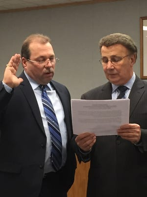Joe Pagano (left) is sworn in as a new member of the Vineland Board of Education on Wednesday night as district Solicitor Bob DeSanto administers the oath of office.