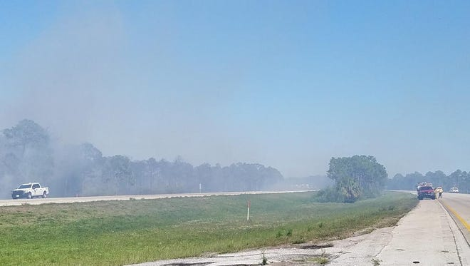 A wildfire Sunday closed parts of Interstate 95 near mile marker 107 near Palm City.