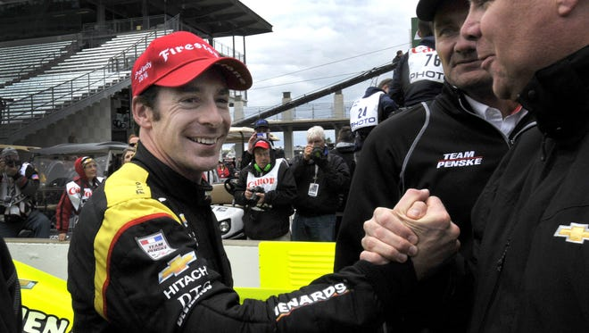 Simon Pagenaud is congratulated by team members following the Angie's List Grand Prix of Indianapolis, May 14, 2016, at the Indianapolis Motor Speedway.