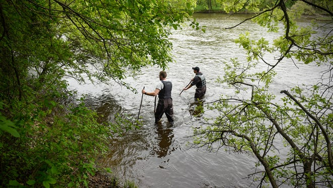 Volunteers Dan Nichols and Lucas Hedtke wade in shallow water in an area of the Mississippi River south of Riverside Park Wednesday, May 17, in St. Cloud during the search for Aaliyah Christine Kazimer.