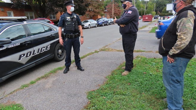 Fourth Ward Neighborhood Watch Chairman Bill Conklin and Assistant Chairman Jesse Boyd talk with Port Jervis Police Officer Seth Mortenson during a drive through the neighborhood.
