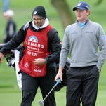 Brandt Snedeker and caddy Scott Vail walk the 15th fairway during the final round of the Farmers Insurance Open on Sunday.