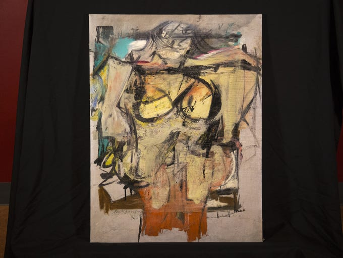 "Willem de Kooning's ""Woman-Ochre"" painting on display,"