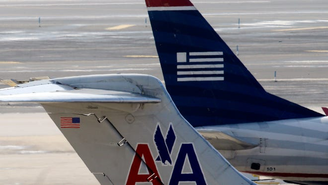 American Airlines and US Airways jets at Philadelphia International Airport on Feb. 14, 2013.