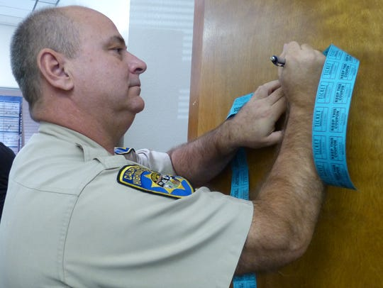 California Highway Patrol Capt. George Peck fills out