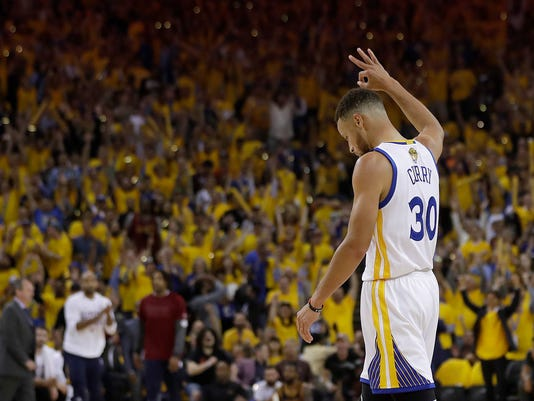 Golden State Warriors guard Stephen Curry (30) reacts after the Warriors scored against the Cleveland Cavaliers during the first half of Game 1 of basketball's NBA Finals in Oakland, Calif., Thursday, June 1, 2017. (AP Photo/Marcio Jose Sanchez)