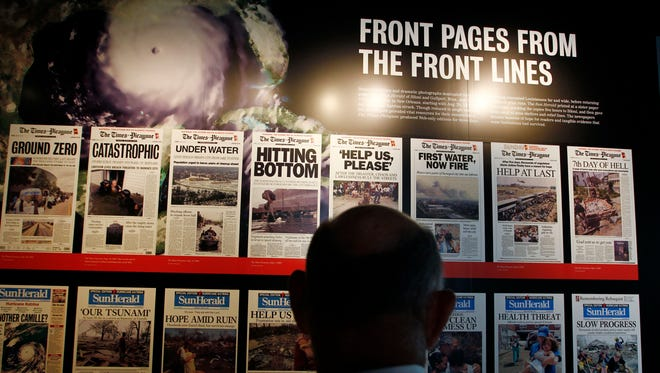 Front pages from The New Orleans Times-Picayune and the Biloxi Sun Herald are seen on display at the Newseum in Washington for their exhibit on newscoverage of Hurricane Katrina and its aftermath, on Aug. 24, 2010.
