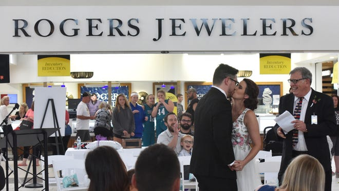 Brent Plooster and Maggie Pettit get married at The Empire Mall in Sioux Falls, S.D. Saturday, June 30, 2018.