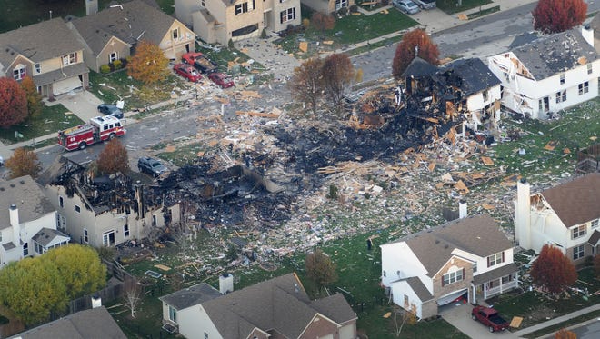 Aerial views of the two homes that were leveled and numerous neighboring homes that were damaged from the explosion in November 2012 in the Richmond Hill subdivision in Indianapolis.