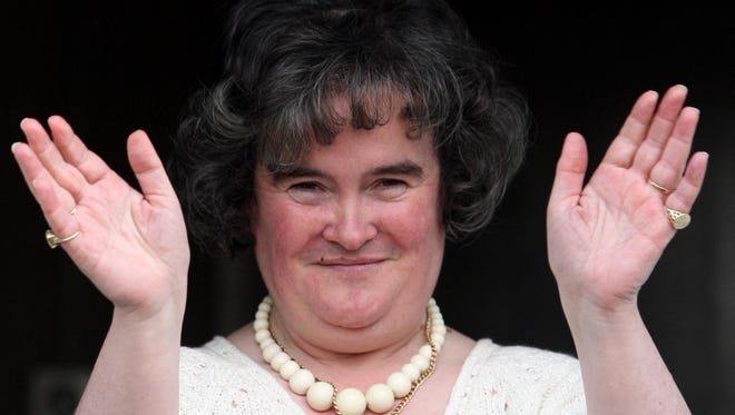 FILE- This is a May 24, 2009 file photo of Britain's Got Talent star Susan Boyle  It's always a bad hair day for Susan Boyle  until she starts to sing. The Scottish songbird with the frizzed-out hair doesn't look like a star. She is a bit chubby, with plain features, and no thousand watt show biz smile. But her golden voice has made her the overwhelming favorite in Britain's Got Talent finals on Saturday May 30. 2009. (AP Photo/Andrew Milligan/PA)  **  UNITED KINGDOM OUT NO SALES NO ARCHIVE  **