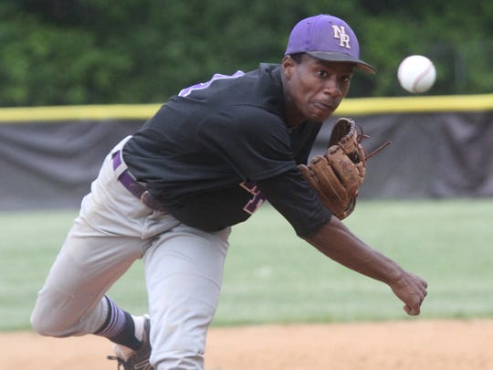 New Rochelle's JoJo Gray delivers a pitch during a Class AA baseball first round game at Clarkstown South May 21, 2015. New Rochelle won 11-1.