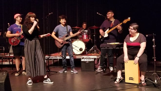 Kevin Medina, left, Ashley Casey, Triston Eaton, Isaiah Talley, Gerardo Diaz and Ericka Van Eckhoutte of the San Juan College Rock Combo rehearse for tonight's performance in the Henderson Fine Arts Center Performance Hall.