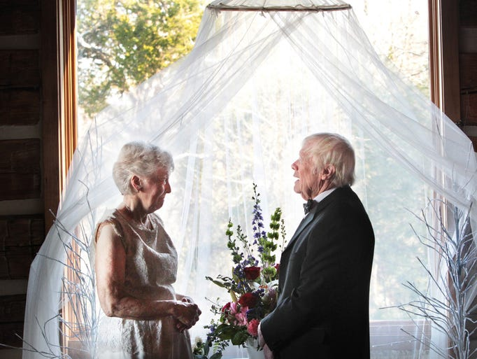 """Former Indiana First Judy O'Bannon, 78, listens as Donald R. Willsey, 84, says his vows as the couple weds in the log barn on the O'Bannon family farm in rural Corydon in Harrison County on Friday, Nov. 29, 2013. The ceremony was """"an acknowledgement of our families coming together,"""" says O'Bannon, widow of Gov. Frank O'Bannon,  who died in 2003 after 47 years of marriage. Willsey, a retired attorney, was married to his wife Ginny for 53 years. She died in 2010 after they were married 53 years. The bride, now Mrs. Willsey, will continue to go by Judy O'Bannon in her public life."""
