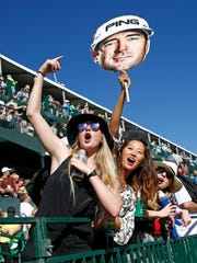 Fans react to Bubba Watson on the 16th hole during