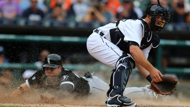 Detroit Tigers catcher Bryan Holaday waits on the throw as the Chicago White Sox's J.B. Shuck scores in the 10th inning on Thursday, June 25, 2015, at Comerica Park in Detroit. The White Sox won, 8-7, in 10 innings.