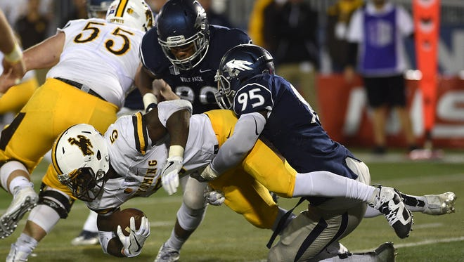 Nevada's Patrick Choudja tackles Wyoming's Brian Hill during a game last season. Run defense was not a strength of the Wolf Pack in 2016.