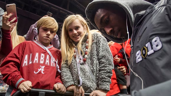 Alabama wide receiver Calvin Ridley (3) signs a autographs  a football for fans during the Alabama Media Day for the College Football Playoff in Atlanta, Ga., on Saturday January 6, 2018.