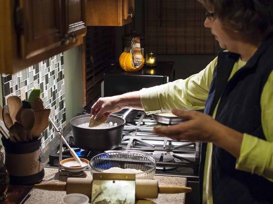 Michele Alexander drops a pierogi into a pot of boiling