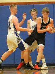 Dayton's Tanner Lewis (right) pulls the ball away from