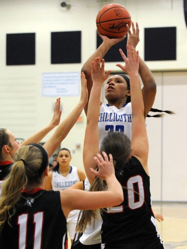 Chillicothe's Osh Brown takes a shot over Logan Elm