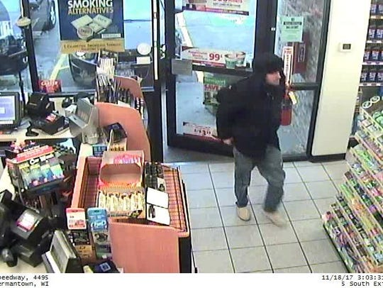 Police are searching for this man and another suspect in connection with a robbery that took place Saturday, Nov. 18, at GT Vapor, N112W15800 Mequon Road. The two stopped at a gas station nearby before the robbery.