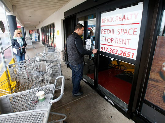 An Uncle Gino's store employee locks the front door after exiting Tuesday morning, April 4, 2017.  The store on Brick Boulevard in Brick closed suddenly Sunday.
