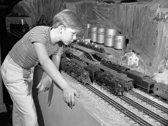New electric trains, seen here Nov. 6, 1946, will go racing around the tracks in many homes this Christmas, as boys (and their fathers) welcome the return of one of the world's favorite toys. Suspended during the war, manufacture of the miniature locomotives and cars started up again after V-J Day, but the supply last Christmas was limited.