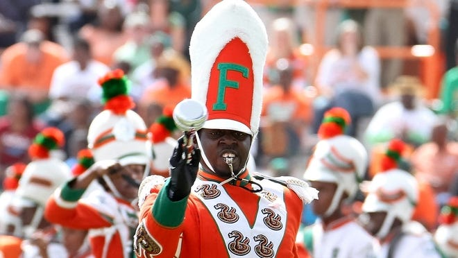 Florida A&M drum major Robert Champion performs in 2011, the year he died after a hazing ritual aboard a band bus.