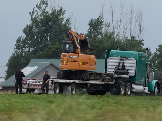 SD Highway Patrol pull over a truck carrying an excavator