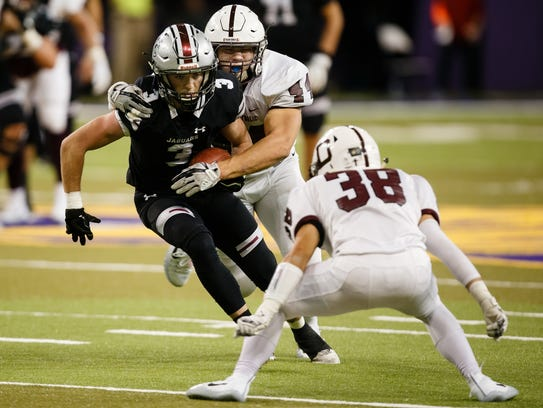 Ankeny Centennial's Brendan Hoy (3) is tackled by Dowling