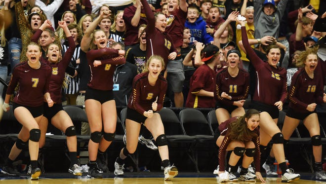 Harrisburg teammates and the student section roar with excitement after defeating Roosevelt to win the S.D. State AA Volleyball championship at the Swiftel Center in Brookings.