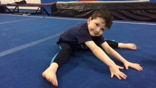 Bennett Shaw of Livonia enjoys his weekly gymnastic class. Gymnastic demonstrations will be part of the fun April 22 during the YMCA Healthy Kids Day.