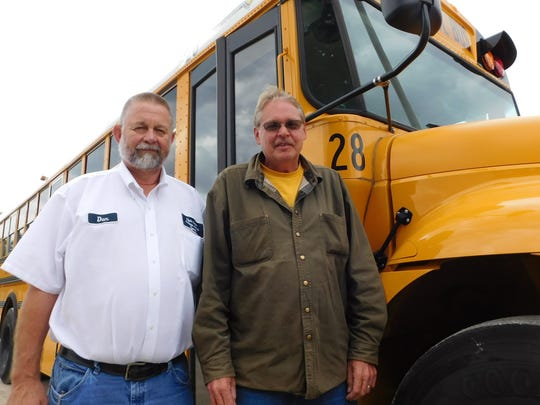 Clyde-Green Springs Schools Transportation Director Dan Shafer, left, and substitute driver Rob Lewis both drive school buses regularly when regular staff drivers are ill or there are just not enough to cover the routes and extracurricular activities.