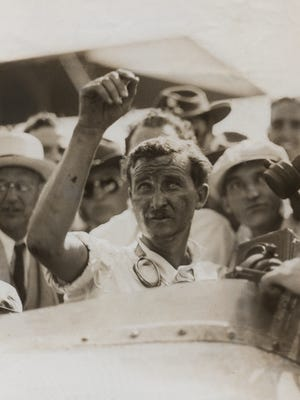 """Wild Bill"" Cummings acknowledges the crowd after winning the 1934 Indianapolis 500."