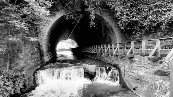 An old fieldstone bridge spans Allen's Creek at entrance to Corbett's Glen in Brighton.  (Jay Reiter photo, 7/1973) TU 7/2/1973