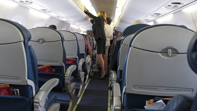 Airline cabins are more crowded than ever, as airlines have reduced capacity.