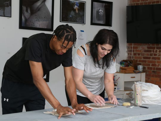 Michelle Petrucci gives a clay sculpting lesson to