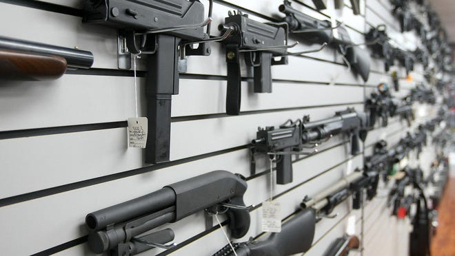DELRAY BEACH -- Assault-style weapons on the wall at Delray Shooting Center.